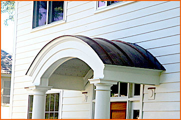 Copper works.  Roof of copper.  Downspouts and Gutter experts.